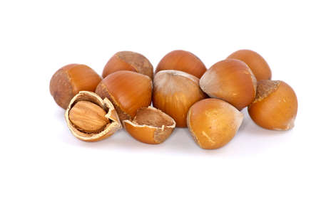 avellan: Small pile of hazelnuts and one cracked isolated on the white background
