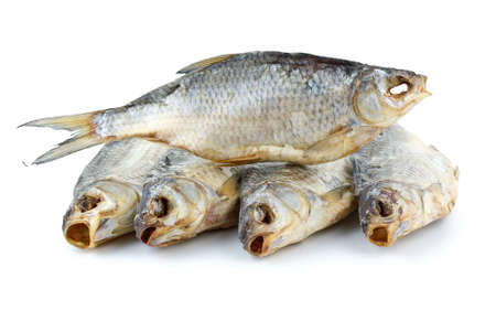 caspian: Five dried sea roach fishes isolated on the white background