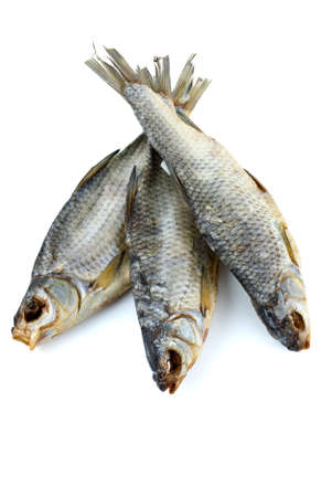 rutilus: Three dried sea roach fishes isolated on the white background
