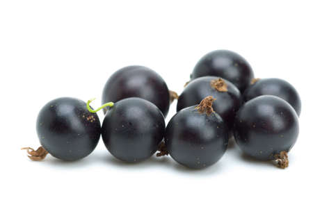 Some blackcurrants isolated on the white background Stock Photo