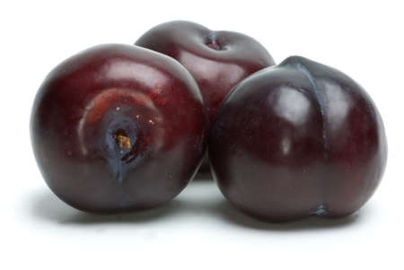 Three plums isolated on the white background photo