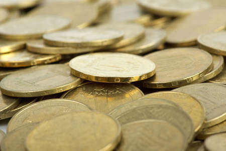 hryvna: Abstract background: Pile of coins. Shallow DOF