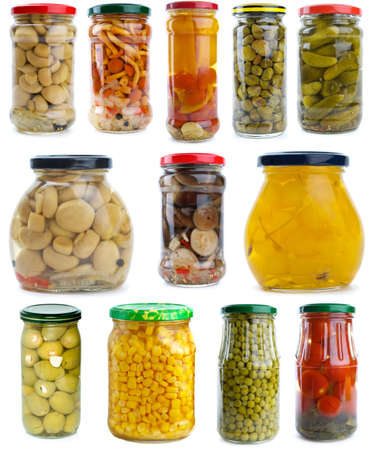 conserved: Set of different berries, mushrooms and vegetables conserved in glass jars isolated on the white background Stock Photo