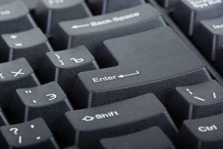 Black computer keyboard close-up. Focused on 'Enter' key Stock Photo - 5581665