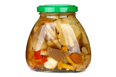 conserved: Mushroom assortment conserved in glass jar (Honey agarics, milky mushrooms). Isolated on the white background