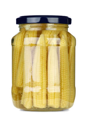conserved: Small corn ears conserved in glass jar isolated on the white background Stock Photo
