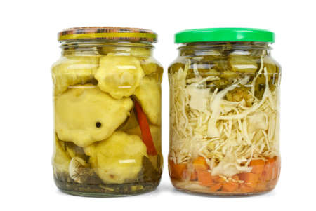 cymbling: Glass jars with marinated cymblings and vegetable assortment isolated on the white background