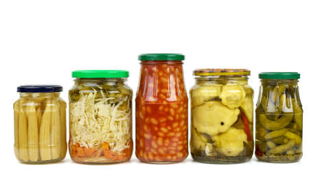 cymbling: Five glass jars with marinated vegetables isolated on the white background
