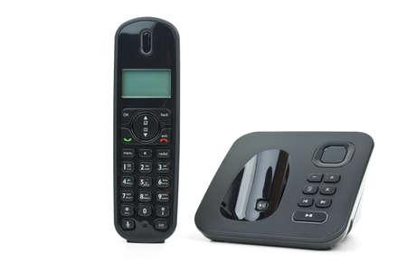 Black wireless phone handset and base unit isolated on the white background photo