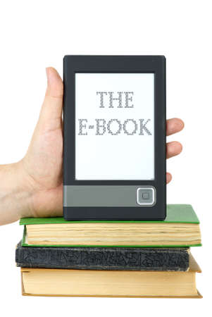 Hand put e-book reader on top of classic paper books isolated on the white background photo