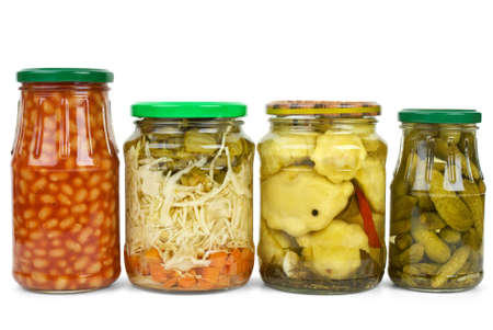 cymbling: Glass jars with marinated vegetables isolated on the white background (Haricot, cabbage, cucumbers and cymblings)