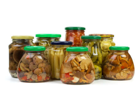 cymbling: Glass jars with marinated vegetables and mushrooms isolated on the white background Stock Photo