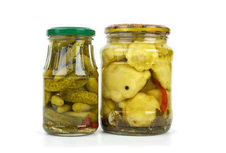 cymbling: Glass jars with cornichons and cymblings isolated on the white background Stock Photo