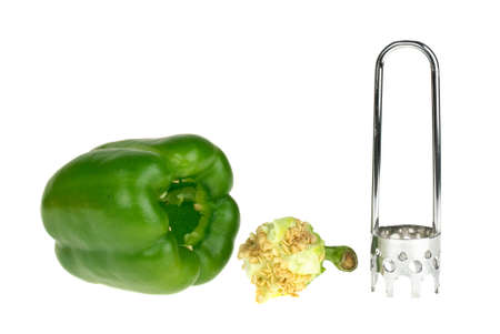 carver: Bell pepper, core and carver tool   isolated on the white background Stock Photo