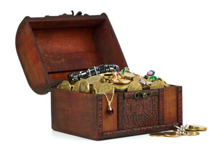 Treasure: wooden chest with golden coins, gems, rings, e.t.c.  isolated on the white background