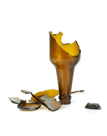 Smashed brown beer bottle isolated on the white background