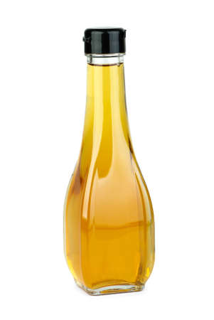 Glass bottle with apple vinegar  isolated on the white background photo