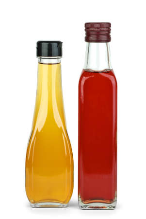 Two bottles with apple and red wine vinegar  isolated on the white background