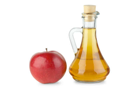 Decanter with apple vinegar and red apple  isolated on the white background Stock Photo