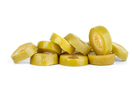 Few sliced green olives  isolated on the white background photo