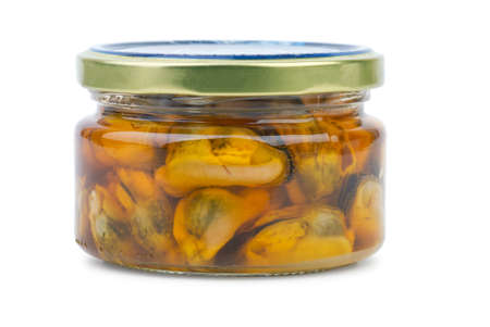 conserved: Glass jar with conserved mussels  isolated on the white background