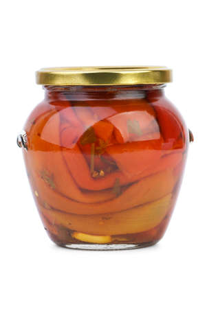 conserved: Glass jar with conserved red bell peppers  isolated on the white background