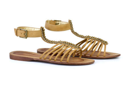 heel strap: Pair of brown leather female sandals  isolated on the white background