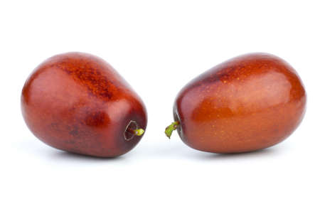 jujube fruits: Two jujube berries  isolated on the white background