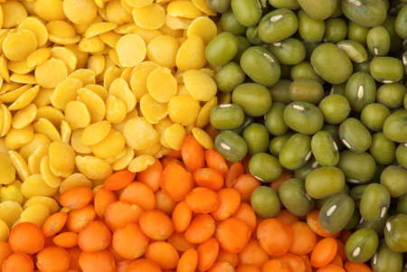 munggo: Abstract background  Yellow split, red  football  lentils and green mung beans Stock Photo