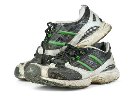 Pair of worn sneakers isolated on the white background