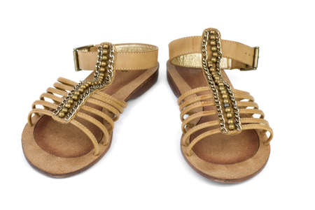 foot ware: Pair of brown leather female sandals isolated on the white background Stock Photo