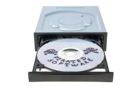 pirated: Optical disk drive with disk, containing pirated software  isolated on the white background