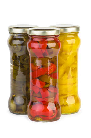 Glass jars with marinated red, yellow, and green pepper slices isolated on white
