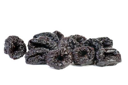 Few prunes isolated on white background