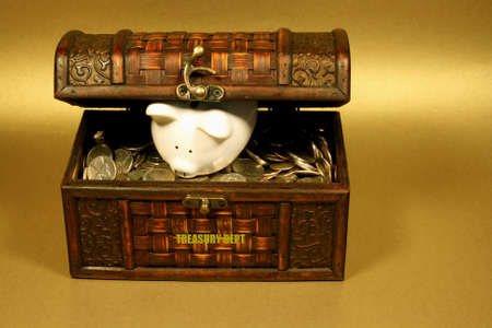 piggy bank in a treasure chest full of coins