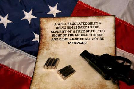 pistol,ammo,and 2nd ammendment on American flag Standard-Bild