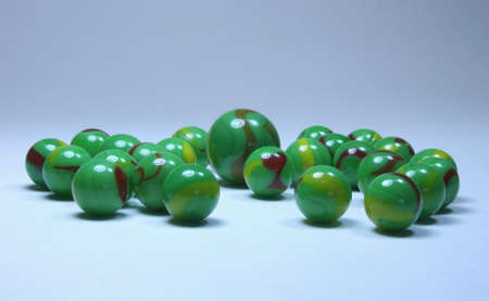 numerous marbles with eyes to represent aliens