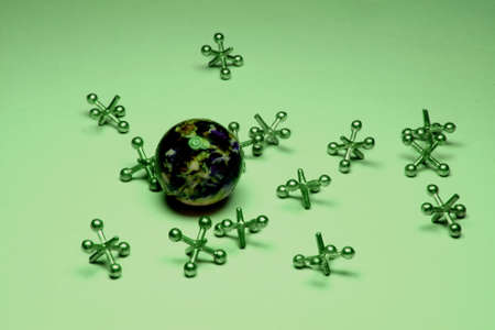 jacks: jacks and rubber ball on a green background