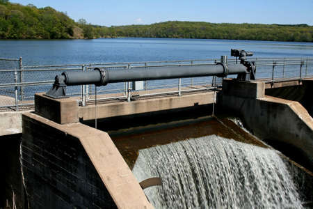 control mechanism for opening and closing the gates on a dam