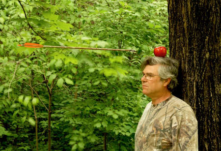 man with apple on head and arrow approaching Stock Photo - 4932262