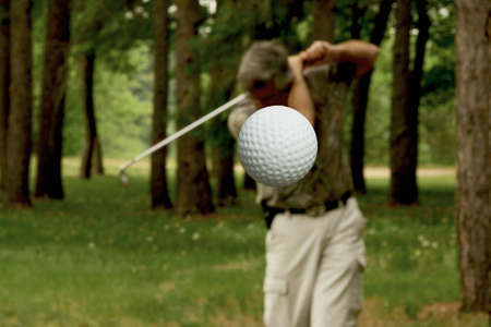 golf ball after leaving tee with man in background Stock Photo - 5004954