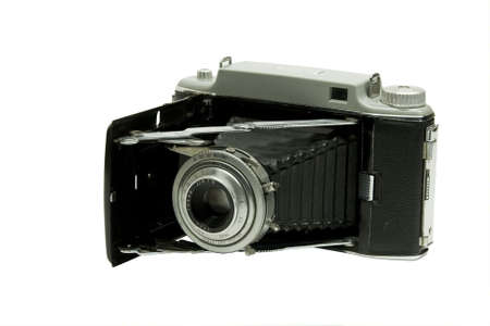 antique film camera in the open position isolated Imagens