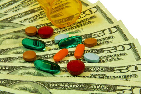 various pills and capsules on fifty dollar bills background Stock Photo - 5344226