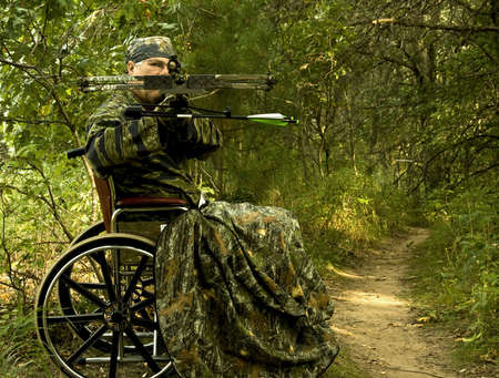 disabled hunter in wheelchair using a crossbow Stock Photo - 5517815