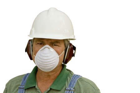 male worker wearing hardhat,ear protection,and dust mask Stock Photo