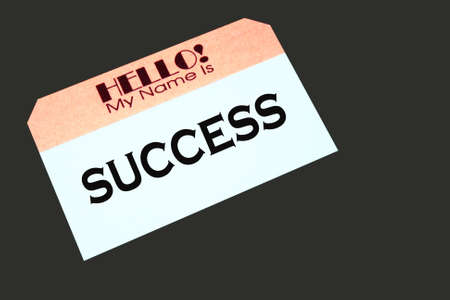 name tag with the word success printed on it Stock Photo - 6174543