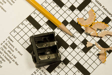 crossword puzzle with pencil, sharpener,and shavings