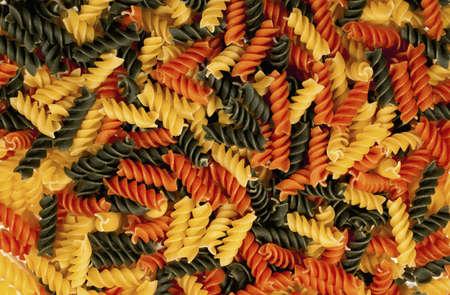 rotini: multi colored rotini pasta for background use Stock Photo