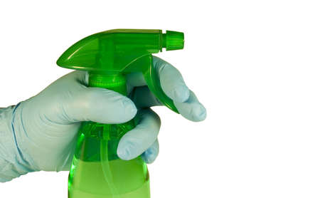 hand with blue glove holding a green spay bottle closeup Stock Photo - 6510623