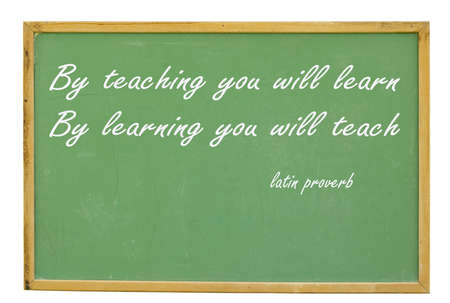 stating: old chalkboard stating by teaching you will learn by learning you will teach with clipping path at this size Stock Photo